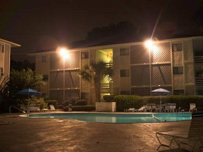 The patio and pool at night.