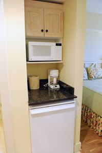 It also has a kitchenette with a microwave, mini fridge, and coffee pot.