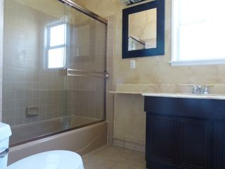 Anaheim house photo - Hall bath, tub/shower, sink and toilet; total 3 baths, no need to fight for bath