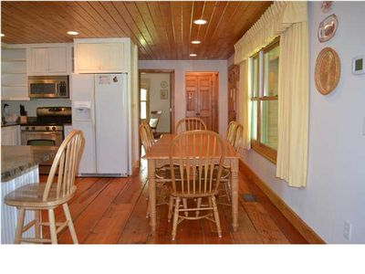 New photo of Rock Creek Cabin Kitchen and entry way.