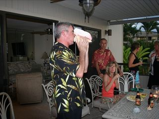 Wailea condo photo - Tradition of Sunset Conch shell horn blowing