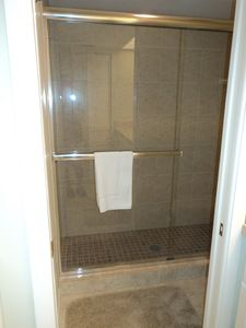 Gorgeous tile walk in shower in master bathroom.