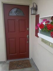 Oceanside apartment photo - Our front red door for managers unit