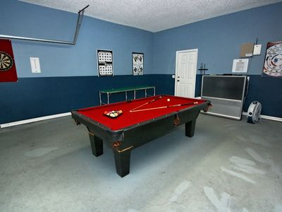 Games room for a game of pool while watching the game on the big screen TV