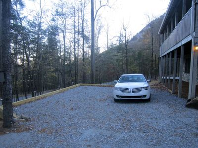 Lake Lure lodge rental - Spacious parking pad allows parking of several vehicles including vans and SUVs.