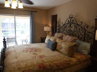 Cape Coral house rental - Master bedroom and sliding door to pool.