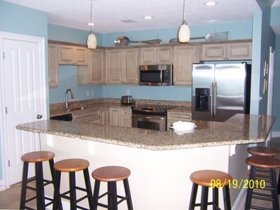 Kitchen from Livingroom.Granite situp bar with seating for seven.