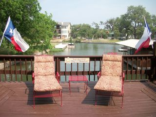 Kingsland house photo - Catching some rays on the comfy chaise loungers! Just another day in Paradise!