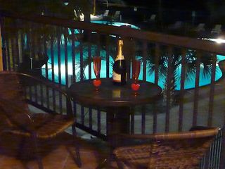 Galveston condo photo - Enjoy the romance of Galveston Tropical Getaway #1 and your private balcony