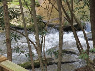 Ellijay cabin photo - View of the Rushing Waters of the stream from the deck!