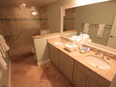 Guest bath with granite counters and ceramic tile, walk-in shower