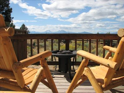 Relax on one of two back decks in front of the fire pit