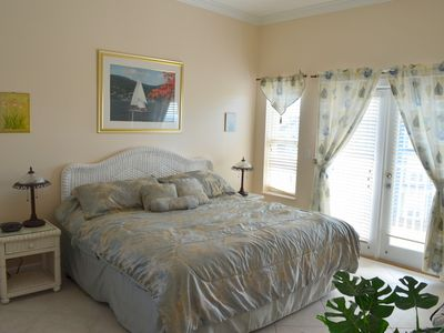 master bedroom, King size bed, door to balcony and deck. Master full BTH