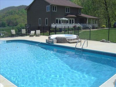 Large pool and hot tub in back yard