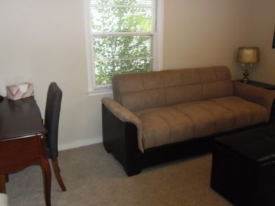 Fort Collins house rental - Back bedroom has a futon making into a full-sized bed. Desk & moveable ottoman