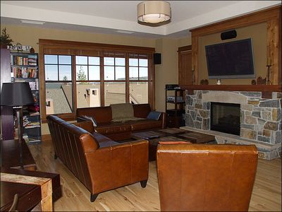 Living Room Includes a Gas Fireplace and Flat-Screen TV