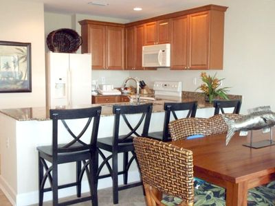Delwood Beach condo rental - Kitchen with breakfast bar and dining area