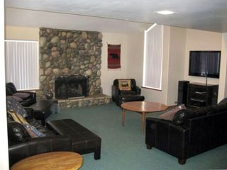 Stone Gas Fireplace with leather sofabeds and Flat Screen TV in Great Room