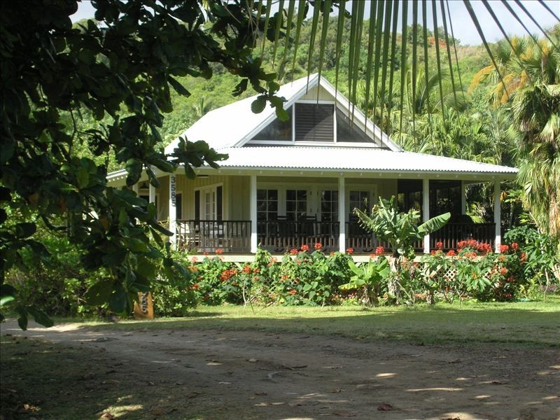 Beautiful plumeria cottage anini beach vrbo for Hawaiian plantation architecture