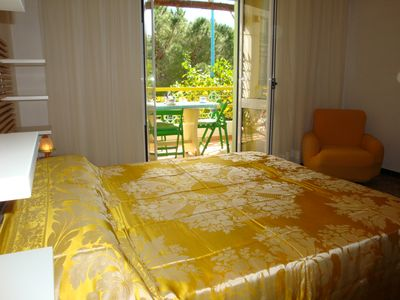 In a nice house with garden. 1 air-con. 10-minute-walk to the sea. With balcony.