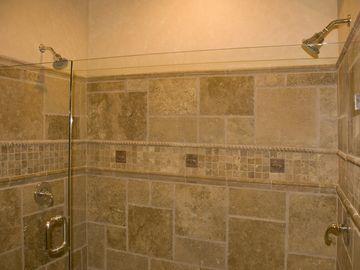 Downstairs double-headed shower - shampoo, conditioner and body soap dispensers