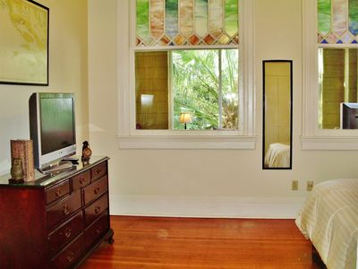 The beautiful wood floors, architecture, and windows of Bedroom 1.