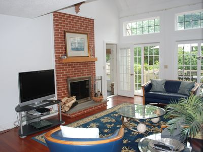 Living room - HD TV, fireplace and door to screened in porch.