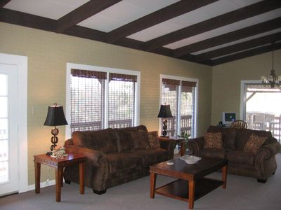 The spacious Family Room overlooking pool & creek.