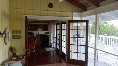 Back screened in sun porch with comfortable seating
