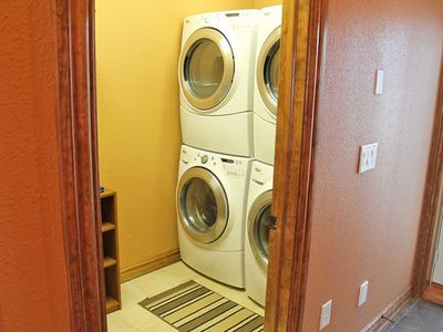 Double washers and dryers. High efficiency and large capacity laundry room