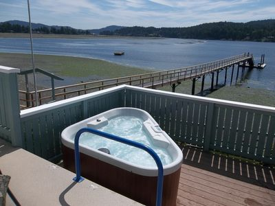 "Soak in the hot tub, while taking in the view and some ""rays""."