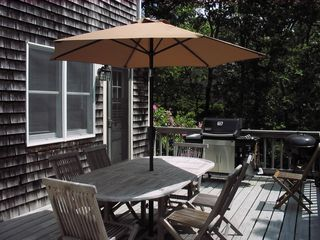 Eastham house photo - Teak table and Weber grill, door to the kitchen