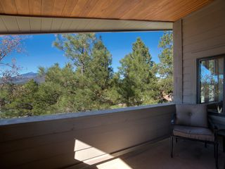 Flagstaff house photo - Deck off great room with view of Humphrey's peak in summer...