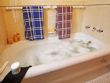 Bubble up and relax in this deep tub and shower