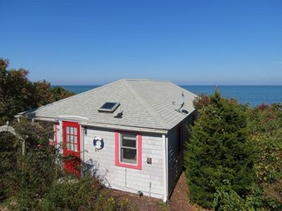Here's your classic Cape beach cottage, directly on a perfect sandy Brewster.