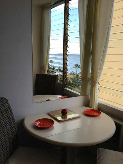 Table and chairs with ocean view.