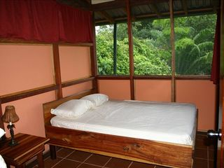 Drake Bay cottage photo - The cabin bedroom with a queen sized bed costom made from exotic hardwood