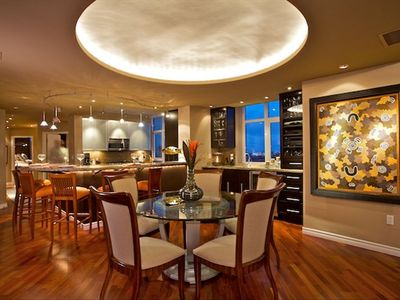 dining with wet bar and custom kitchen with 6 bar stools