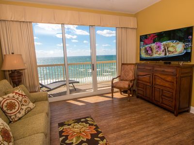 Living room with flat screen HD TV also features breathtaking gulf views
