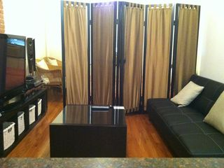 Midtown Manhattan property rental photo - Two single beds in living area + sofa bed