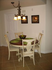 French country dining set in dining area off of kitchen.