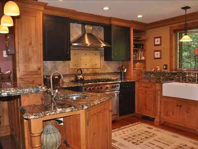 Main level-Gourmet kitchen with six burner wolf range, farm sink,island seating