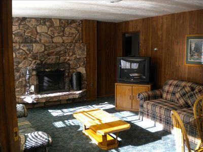 Middle Floor Living Room with fireplace,large tv, and hide-a-bed