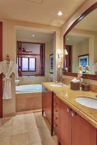 The master bath has a deep soaking tub with direct views of the Pacific Ocean.