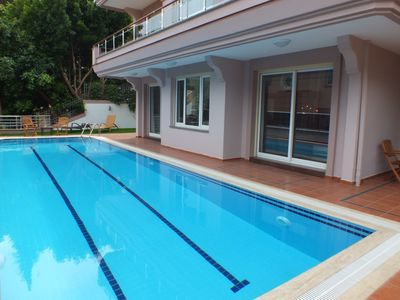 Luxurious holiday flat with garden and pool