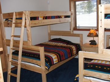 Kids room with versatile adult sized bunks