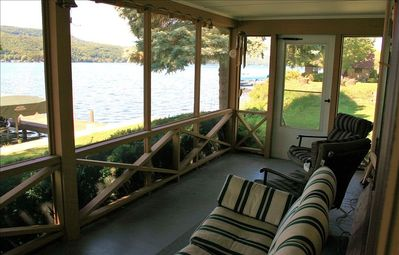 Relax on the shady porch just steps away from the lake!