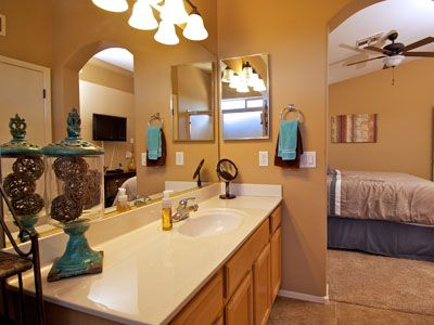 Large Private Master Bathroom with ample counter space and an extra linen closet
