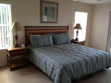 Master Bedroom featuring a King Size bed, all new linens and a private balcony!