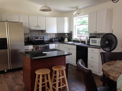 Newly remodeled kitchen with granite island